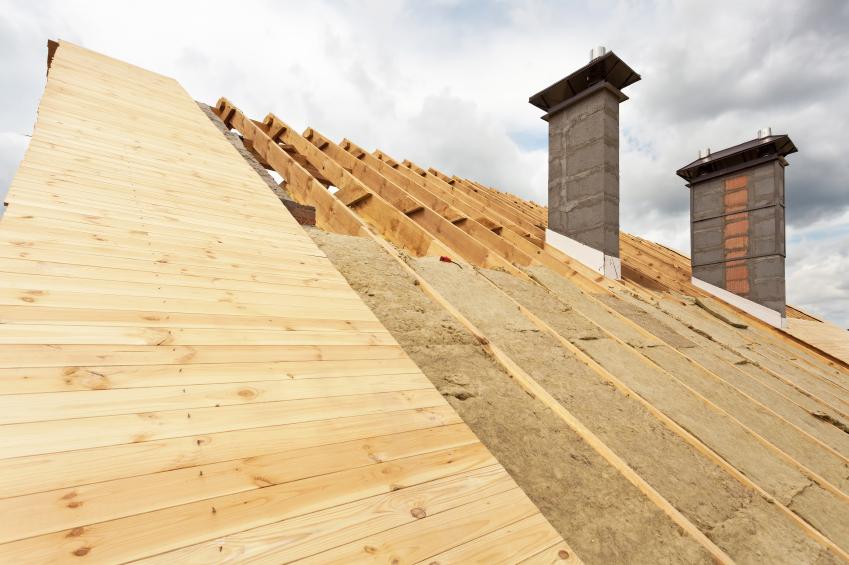 Roof under construction.Installation mineral wool insulation.