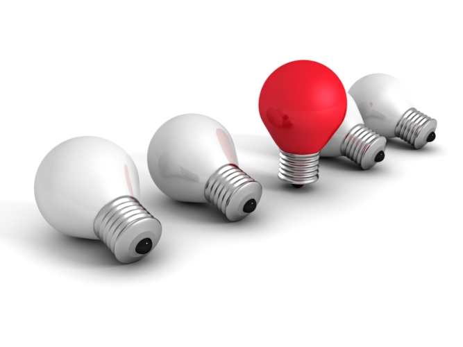 different red idea light bulb on white. creativity concept
