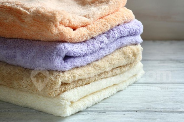 Towels on wooden boards, closeup