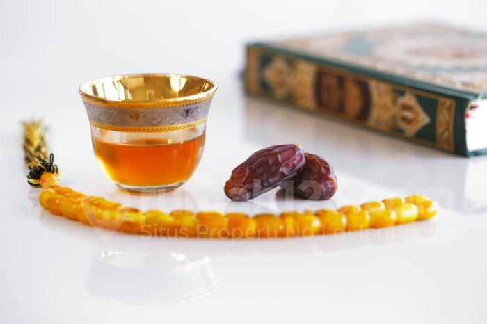 The Masbaha is also known as Tasbih photographed here with the Quran, Arabic Tea and dried dates - all symbols of Ramadan