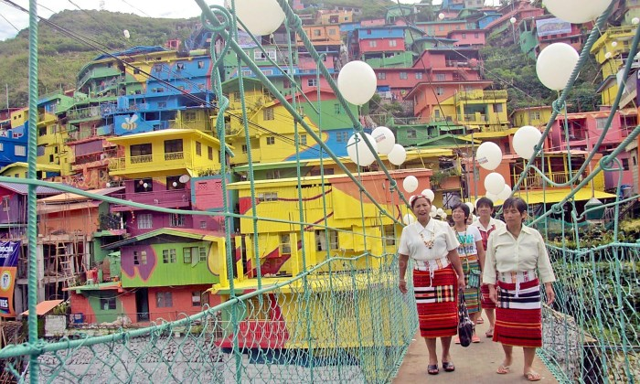 HILLSIDE HOME ARTWORK – Dept. of Tourism Sec. Ramon Jimenez. Jr unveiled the STOBOSA Hillside Homes Artwork, Thursday, morning. The art work is a work in progress with some 600 volunteers painting the houses at Sitios Stonehill, Botiwtiw and Sadjap (STOBOSA) with the art direction from Tam-awan Artist and paints from Davies. - Photo by JJ Landingin and File: MBpictures_June.2016/230616_Hillside_Home_Artwork_07_JJLandingin