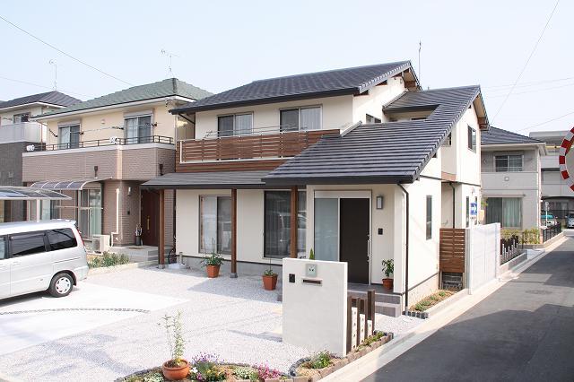 Desain rumah hook 2 lantai_