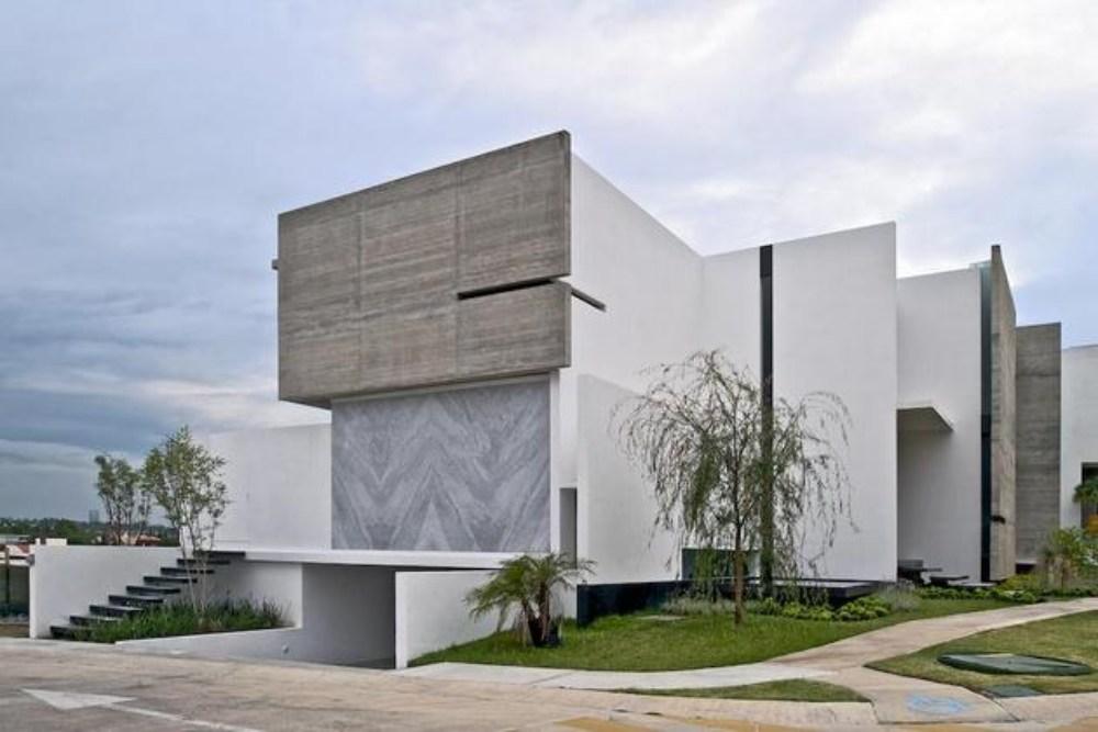 Rumah-pojok-2-lantai-dengan-fasad-unik